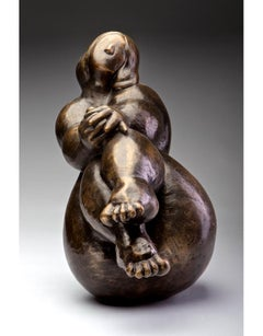 """Wiggle My Toes"" Bronze sculpture of a curvy woman with crossed legs in front"