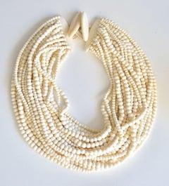 Monies 28 Strand White Bone Bead Necklace