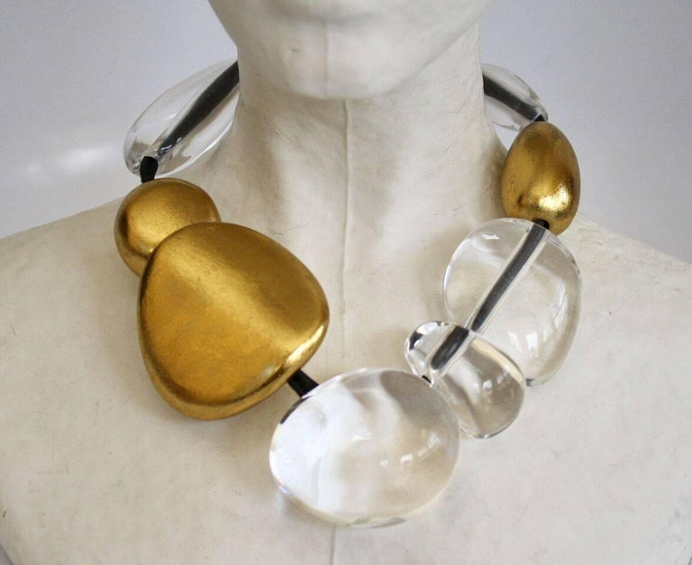 Clear acrylic and gold leaf bead necklace with leather cord from Monies.