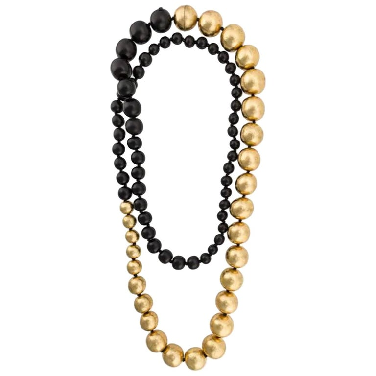 Monies Black and Gold Leaf Wood Bead Necklace  For Sale