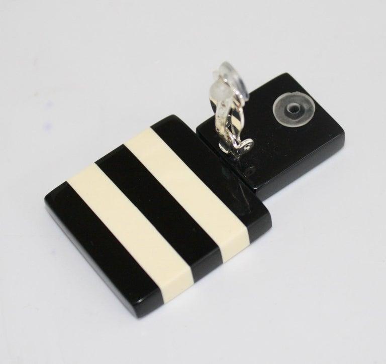 Polyester black and white clip earrings from Monies Denmark.