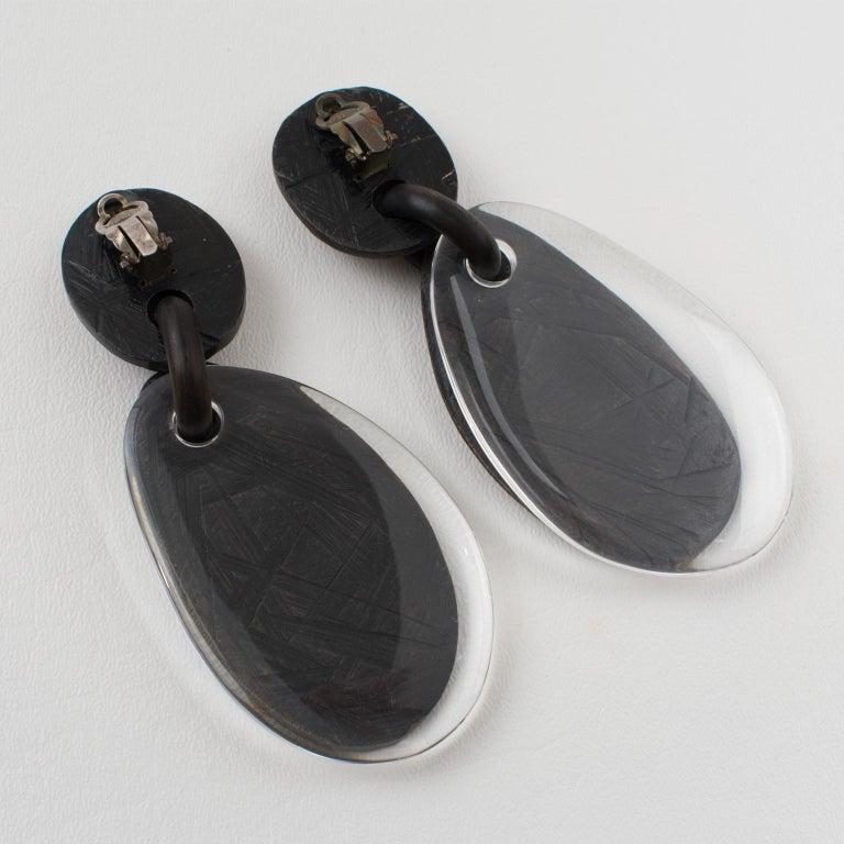 Women's or Men's Monies Dangle Oversized Clip Earrings Acrylic and Ebony Wood For Sale