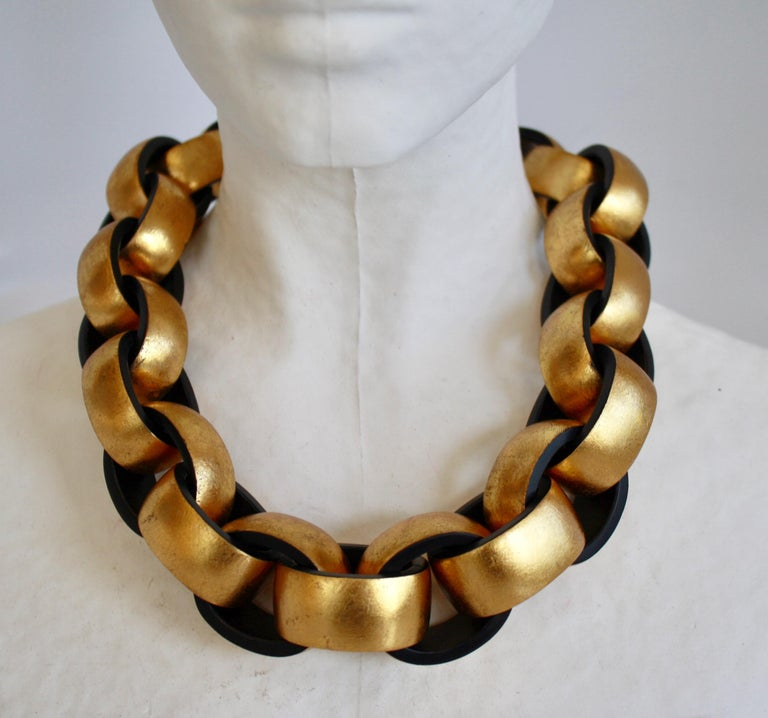 Gold leaf painted on ebony wood link necklace from Monies Denmark.