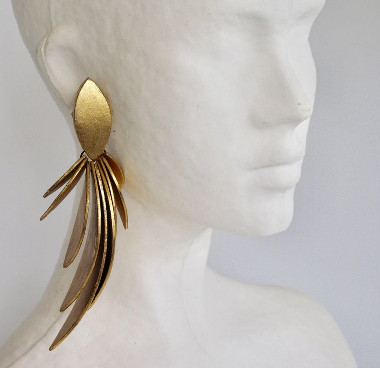 Feather inspired gold leaf and ebony wood clip earrings from Monies. Very lightweight despite the bold look.