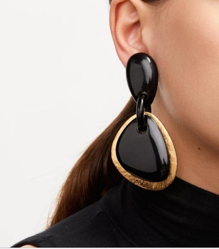 Chic and lightweight black horn and gold foil clip earrings from Monies Denmark.