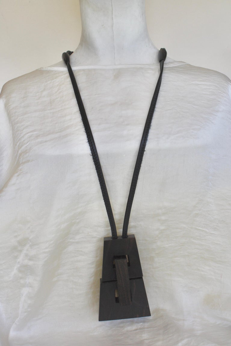 Leather and wood pendant necklace from Monies Denmark. Pendant is 2.75