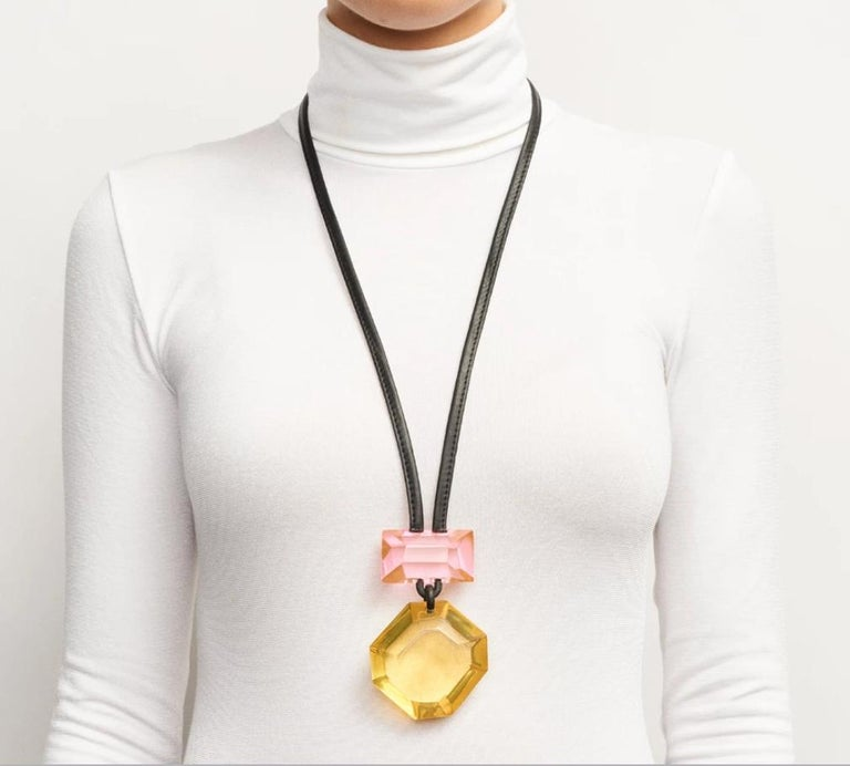 Yellow and pink lightweight polyester necklace on leather cording from Monies Denmark.