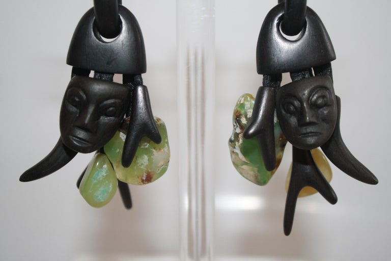Hand carved ebony wood clip earrings with Chrysoprase stones throughout from Monies, Denmark.