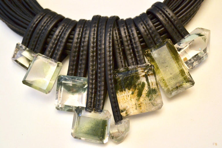 One of a kind statement piece from Danish designer Monies. This necklace is made with multiple strands of leather and Mountain Crystal drops.
