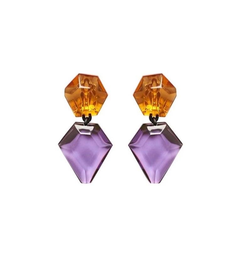 Orange and purple polyester lightweight clip earrings from Monies Denmark.