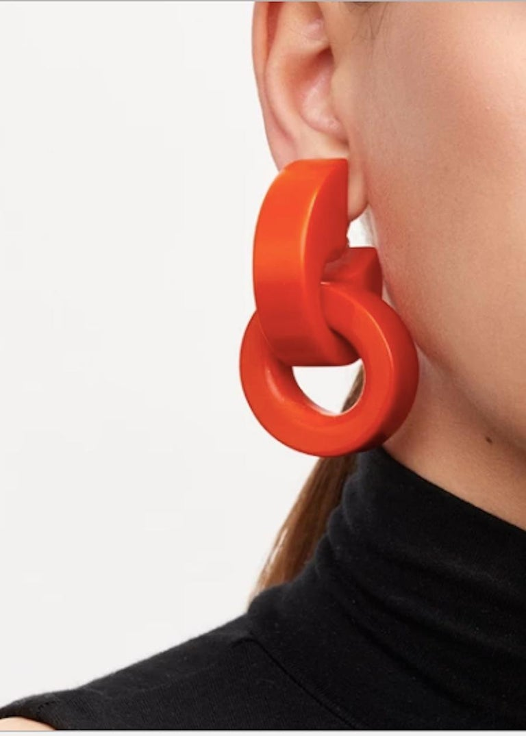 Red rose polyester lightweight clip earrings from Monies Denmark.