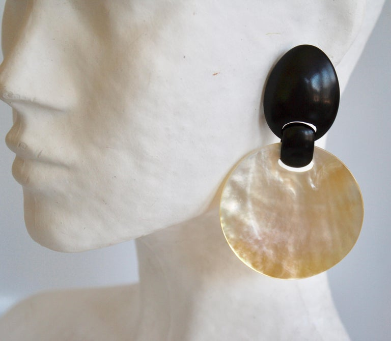 Round shell disc clip earrings with ebony wood top from Monies Denmark.
