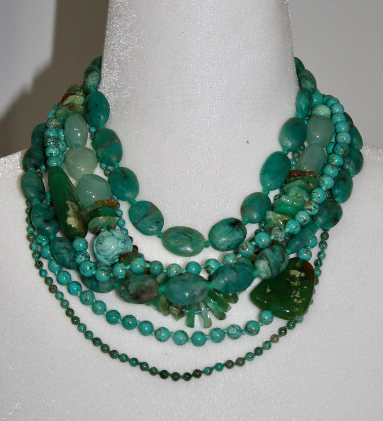 7 strands of semi precious stones in shades of green create this unique creation by Monies. Another example of their exceptional work.