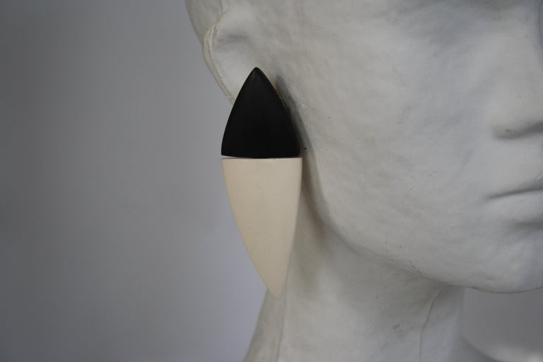 Double triangle clip earrings made with bone and wood from Monies Denmark.