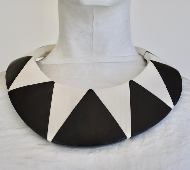 Collar necklace made with ebony wood and polyester with magnetic closure from Monies Denmark. Circumference is 5.5