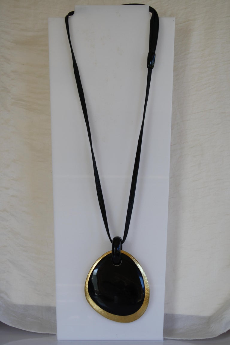 Wood, leather, and horn pendant necklace from Monies Denmark.