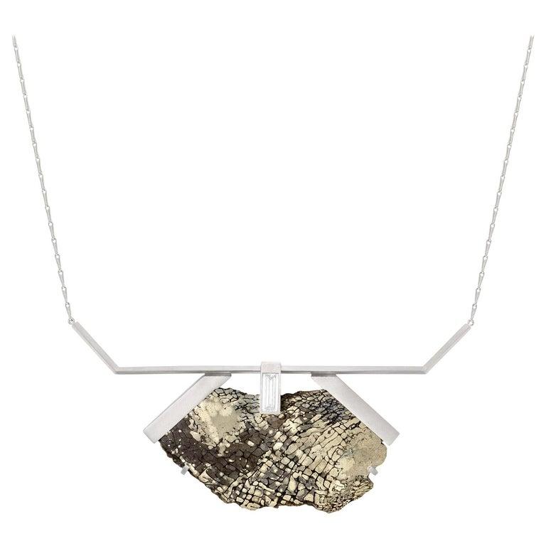 Pyritized dinosaur bone and 1.43-carat white diamond necklace