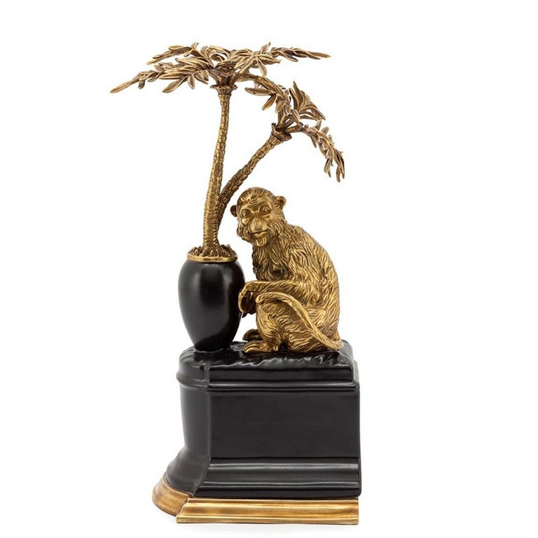 Bookends monkeys and palms set of 2 in solid bronze and with base in hand painted porcelain. Measures: L 17 x D 17 x H 33cm each piece.