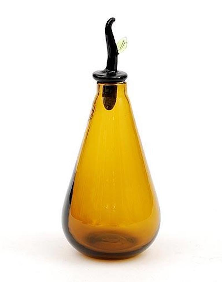 Monofiori glass bottle collection, designed by Laura de Santillana and manufactured by Venini, features six different shaped bottles.  Indoor use only.  Dimensions: Ø 9 cm, H 15 / top 7.5 cm.