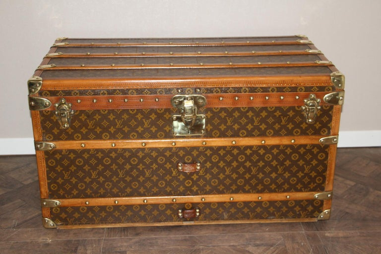 This beautiful Louis Vuitton trunk is all stenciled LV monogram canvas, with all Louis Vuitton stamped brass hardware and lozine trim. It features large leather side handles as well as customized painted French flag on each side. It has got a very