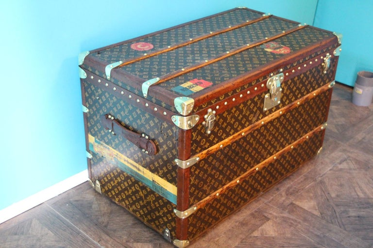 This beautiful Louis Vuitton trunk is all stenciled LV monogram canvas, with all Louis Vuitton stamped brass hardware and lozine trim. It features large leather side handles as well as customized painted stripes on each side as well as couple of