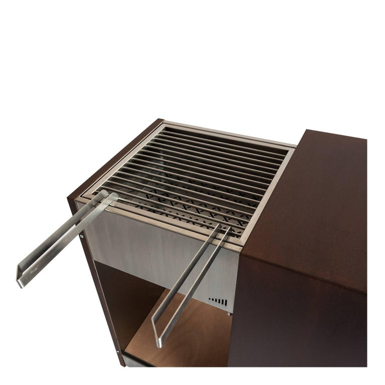 Italian Contemporary Compact Garden Charcoal Barbecue with sliding grills, Snail Mono For Sale