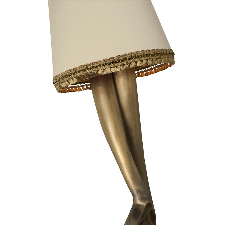"""1. Product description:  The """"Monroe"""" floor lamp is made of oxidized brushed brass cast with a lampshade adorned by a gold tassel fringe complementing the set. After smelting, a process known for thousands of years widely used in brass and bronze"""