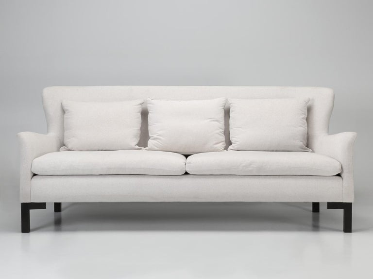 Montauk sofas are upholstered products that are handmade in Montreal, Canada. The solid wood frames have springs that are held in place by eight-strand flax rope and all are covered by memory foam and down filled feather cushions. Our Montauk sofa