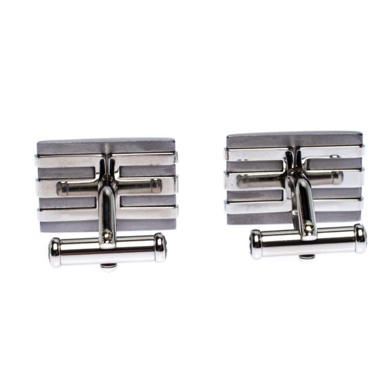 Montblanc's cufflinks are sure you to make an impression on you. The two-toned cufflinks are meticulously made from stainless steel and tantalum and they have a rectangular shape accented with a striped design along with the brand label engravings.