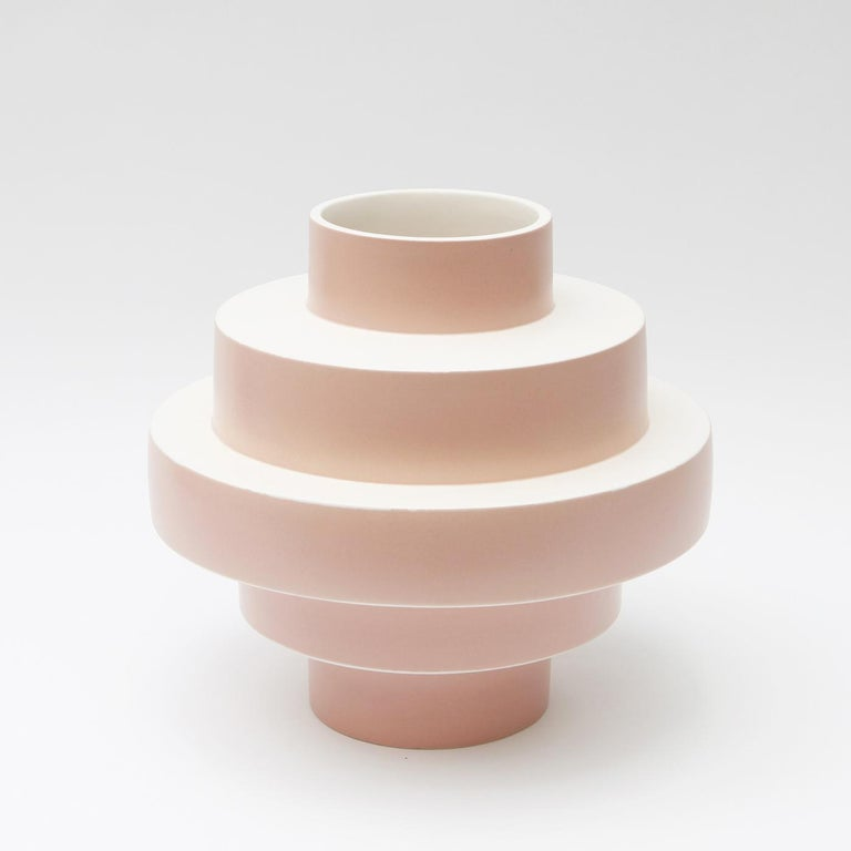 Show off your favorite flowers in style and enhance the look of your contemporary decor with the elegant and dynamic Monté vase in soft pink ceramic. Entirely hand crafted, this delightful accessory features a clever shape of layers of concentric
