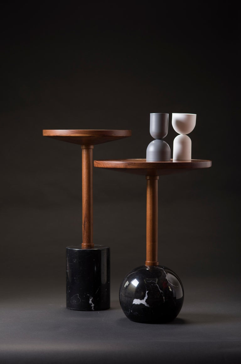 Honoring the process of craftsmanship, geometry makes poetry in the Mesas Monterrey. Both tables are turned by hand; the bases are made of a marble cylinder and sphere, the tops are made of solid tzalam wood in two different diameters. With