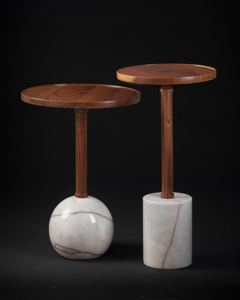 Honouring the process of craftsmanship, geometry makes poetry in the Mesas Monterrey. Both tables are turned by hand; the bases are made of a marble cylinder and sphere, the tops are made of solid tzalam wood in two different diameters. With