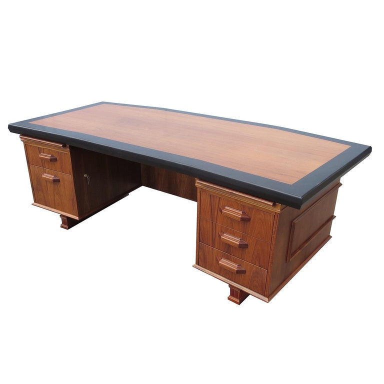 This wonderfully stylish desk was designed in 1970 by Maurice Bailey for the Monteverdi Young Furniture company. Monteverdi Young was known as one of the finest makers of executive office furnishings of the period. The desk is all walnut, with very