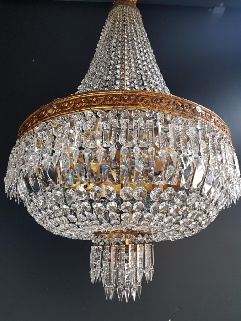 Cabling and sockets completely renewed. Crystal hand knotted Measures: Total height 140 cm, height without chain: 110 cm, diameter 60 cm, weight (approximately) 15 kg.  Number of lights: 9-light bulb sockets: E27  ------two identical chandeliers