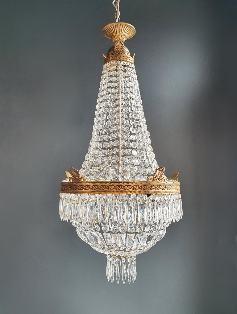Cabling and sockets completely renewed. Crystal hand knotted Measures: Total height 140 cm, height without chain: 99 cm, diameter 47 cm, weight (approximately) 13 kg.  Number of lights: 6-light bulb sockets: E14     Montgolfiè Empire brass