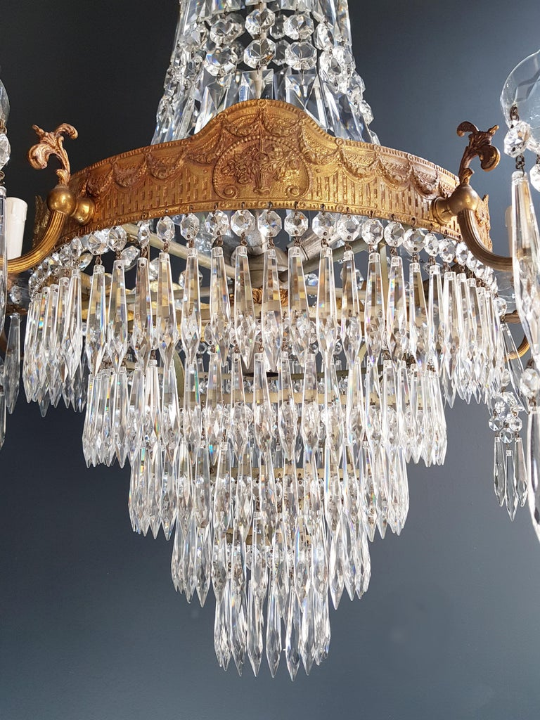 Cabling and sockets completely renewed. Crystal hand knotted Measures: Total height 130 cm, height without chain: 120 cm, diameter 70 cm, weight (approximately) 15 kg.  Number of lights: 15-light bulb sockets: 14 x E14 and 1 x E27  Montgolfiè