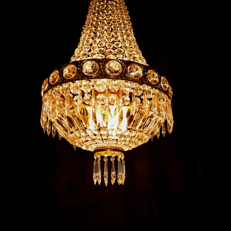 Original preserved chandelier, circa 1940. Cabling and sockets completely renewed. Crystal hand-knotted Measures: Total height: 130 cm, height without chain: 85 cm, diameter 43 cm, weight (approximately) 7 kg.  Number of lights: Six-light bulb