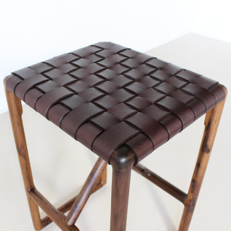 Montgomery stool Solid wood frame / handwoven vegetable tanned leather seat / no VOC oil finish  Dimensions:  14 W X 16 DX 24 H 14 W X 16 DX 30 H  Wood: walnut, maple, blackened, white oak  Leather: Natural, Black, Brown.