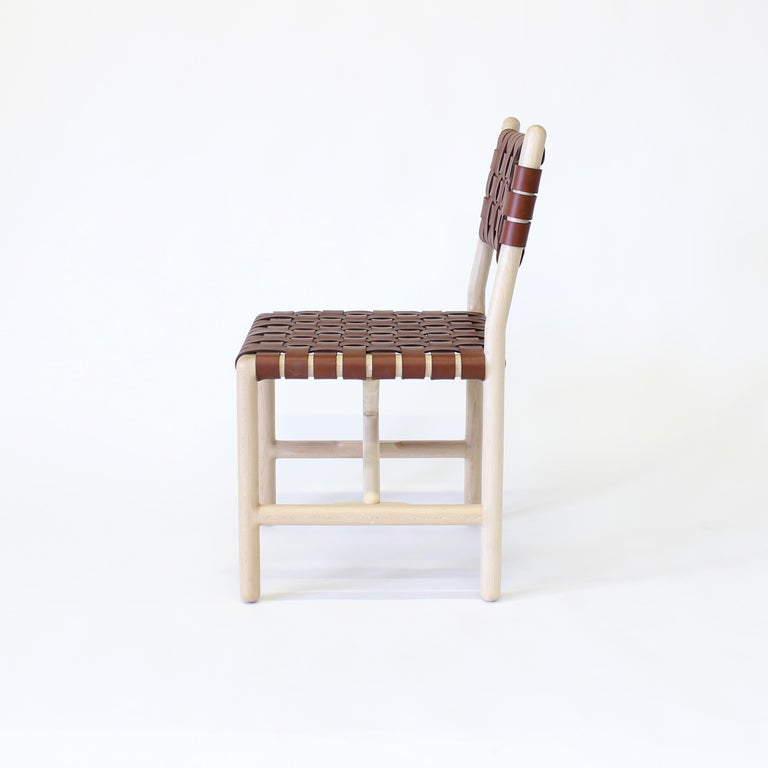 Montgomery dinning chair by Crump and Kwash   Hand shaped solid wood frame / hand rubbed oil finish / handwoven vegetable tanned leather seat and back  Dimensions - 20 W x 21 D x 34 H  Seat height - 18    Wood options - Walnut, maple, white