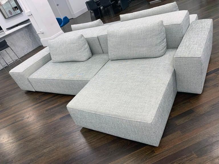 Domino modular sofa upholstered in Mellow 60 consist of: (2) Pillows 80 x 40 cm (2) Pillows 95 x 40 (2) module 60mm (75 x 150 x 40)cm (2) module (100 x 125 x 40cm) (1) module on castors 50 x 125 x 52cm (1) module 25 x 100 x 52 (2)proto (50 x
