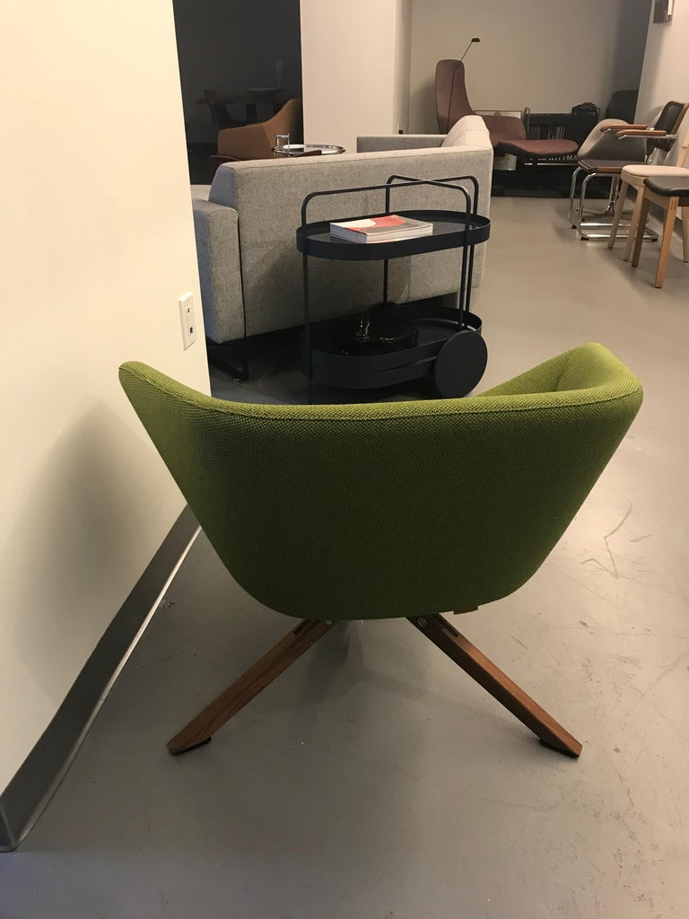 ELLA Chair Design: Niels Bendtsen. Ella is a compact seat allowing you to adopt all manner of sitting postures easily while properly supported at all times. A notable feature is its buckled dish shape which, together with its geometrically faceted