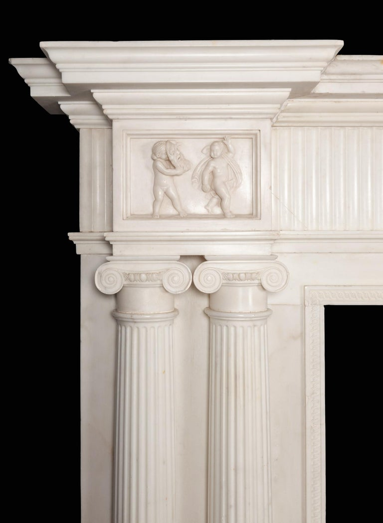 An outstanding and very large 18th century neoclassical statuary marble chimneypiece. Originally from Eglinton Castle, Scotland, designed by John Paterson.  The jambs with twin fluted ionic columns, support carved blockings of putti holding Roman
