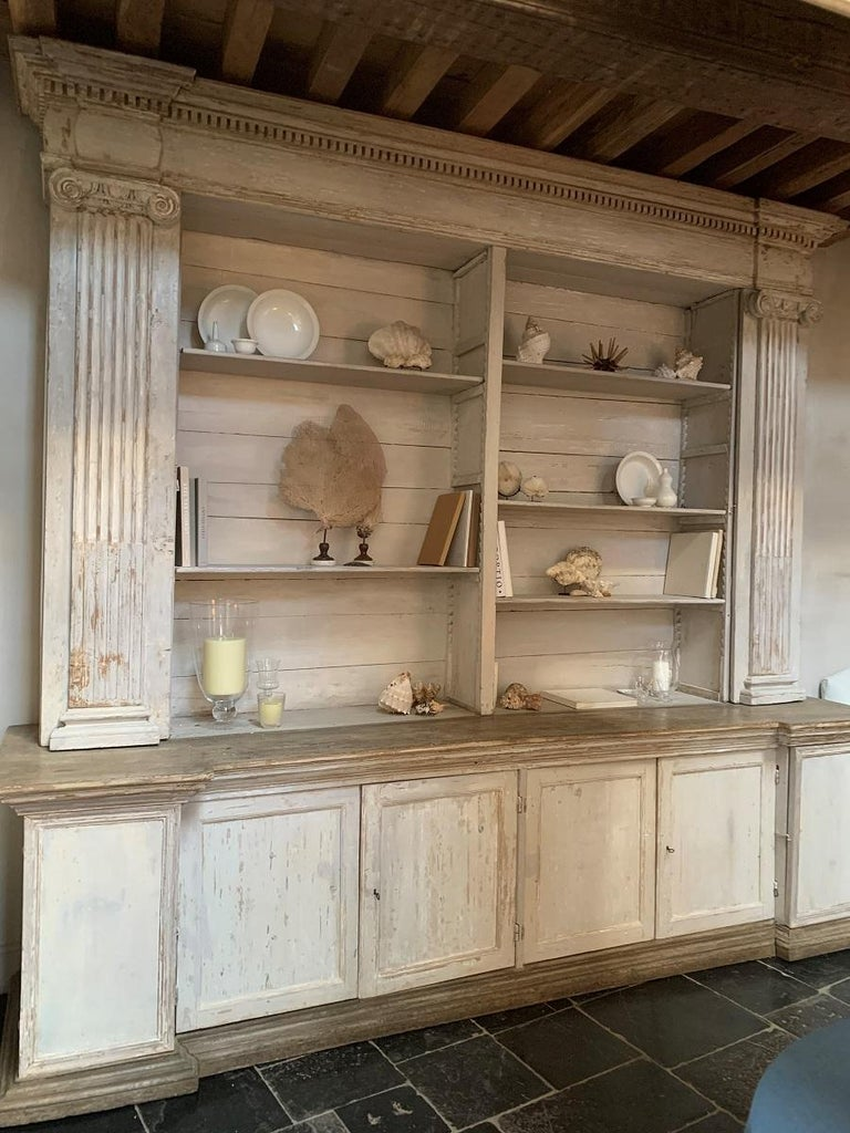 A large open display cupboard/bookcase. Made in Mantua Italy at the end of the 18th century for a monastery from local poplar and pine. Beautifully proportioned neoclassical style with ionic kapitels and fine moulding. Hidden doors in the colomns