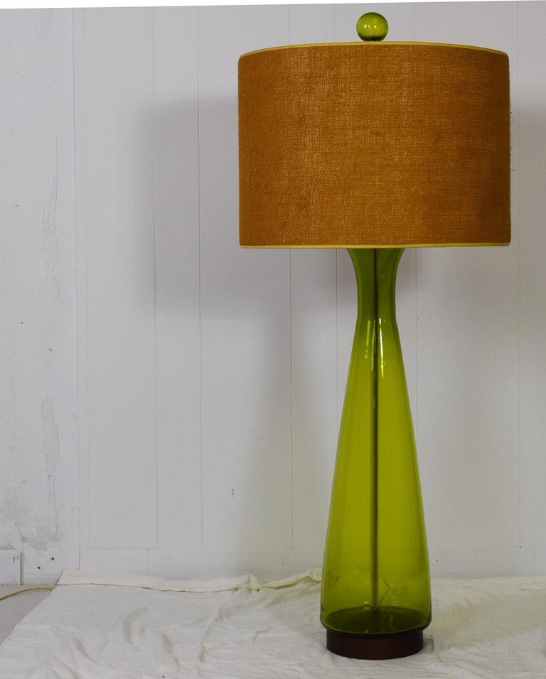 Blenko, USA, 1964 Green hand blown art glass Each measures 48.25