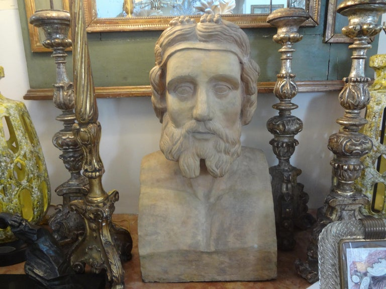 French terracotta bust/head (25 inches H) sculpture of a Classical Greek figure. This fabulous monumental French bust dates to mid-19th century.