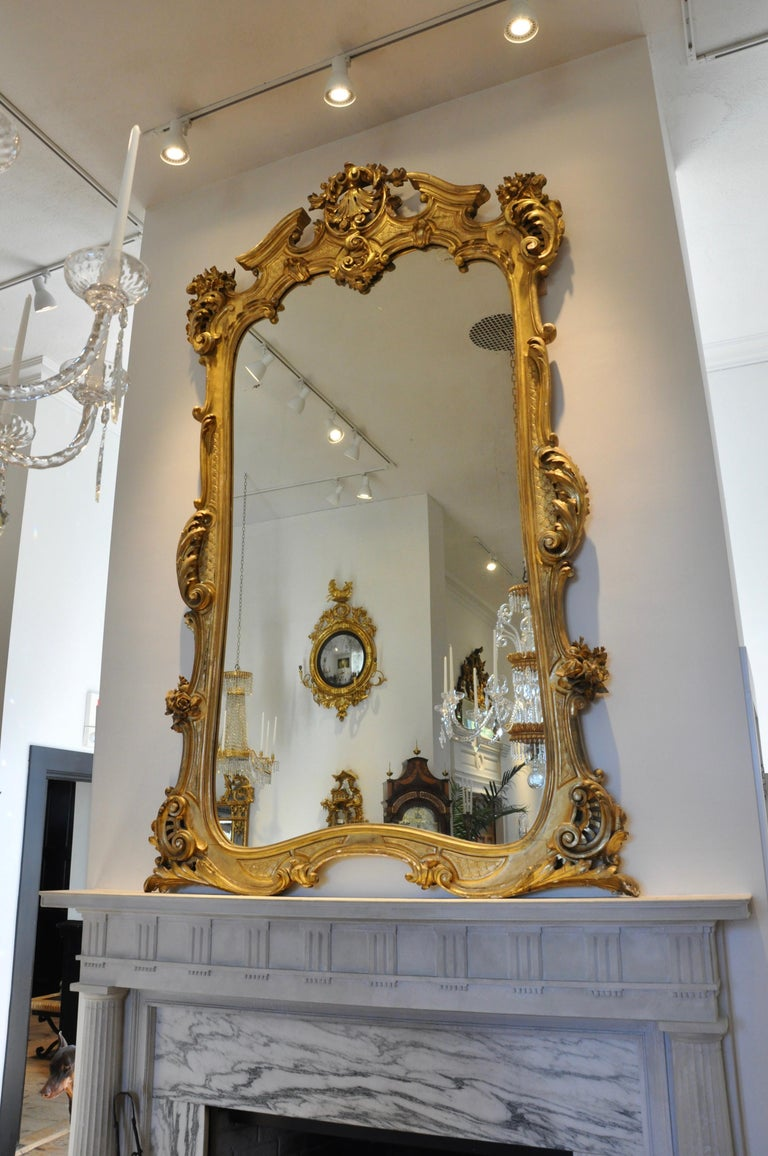 Large-scale 19th century giltwood pier or overmantle mirror  Louis XV style mid-19th century carved and gilt overmantle or pier mirror. Original glass and original gilding. Massive in proportion beautiful neoclassical foliate and floral carving.