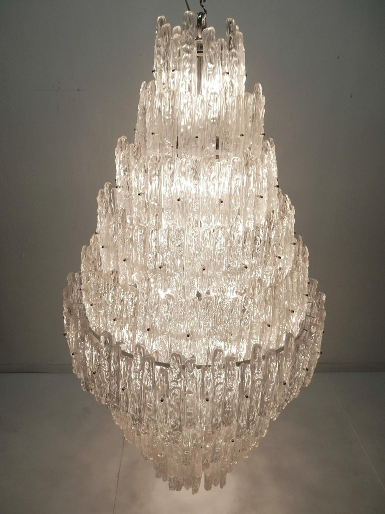 World's largest J.T. Kalmar style Lucite ice sculpture chandelier. Contains 50 candle bulbs surrounded with 160 crystals suspended on a steel frame. Huge piece measuring over 5 feet end to end. Judging by the construction it was custom made in the