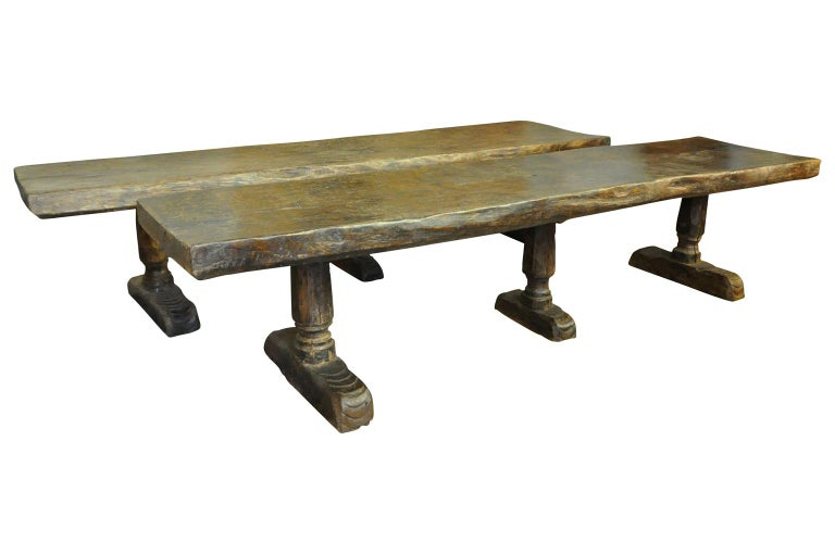 A pair of monumental and very rare 16th century castle tables - trestle tables from the South of Spain. These truly exceptional tables are very sturdily constructed from richly stained green oak with sensational and very thick solid board tops,