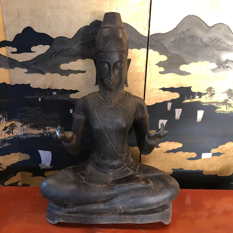 Unusual one-of-a-kind opportunity, Old UK collection.  This antique bronze seated spiritual figure Reusi (Rishi in Sanskrit) is a seldom seen practitioner dedicated to spiritual teaching.  Posed as a teaching hermit, he is seated in padmasana or