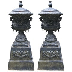 Monumental Antique Covered Cast Iron Urns on Plinths and Lion Head Handles, Pair